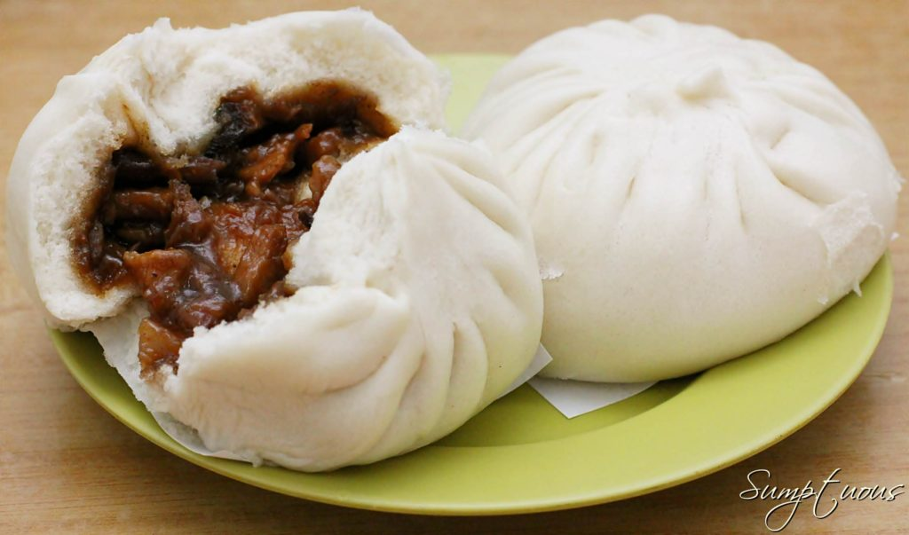 Pork bun is a white fluffy filled delicious snack of Beijing, China- served warm