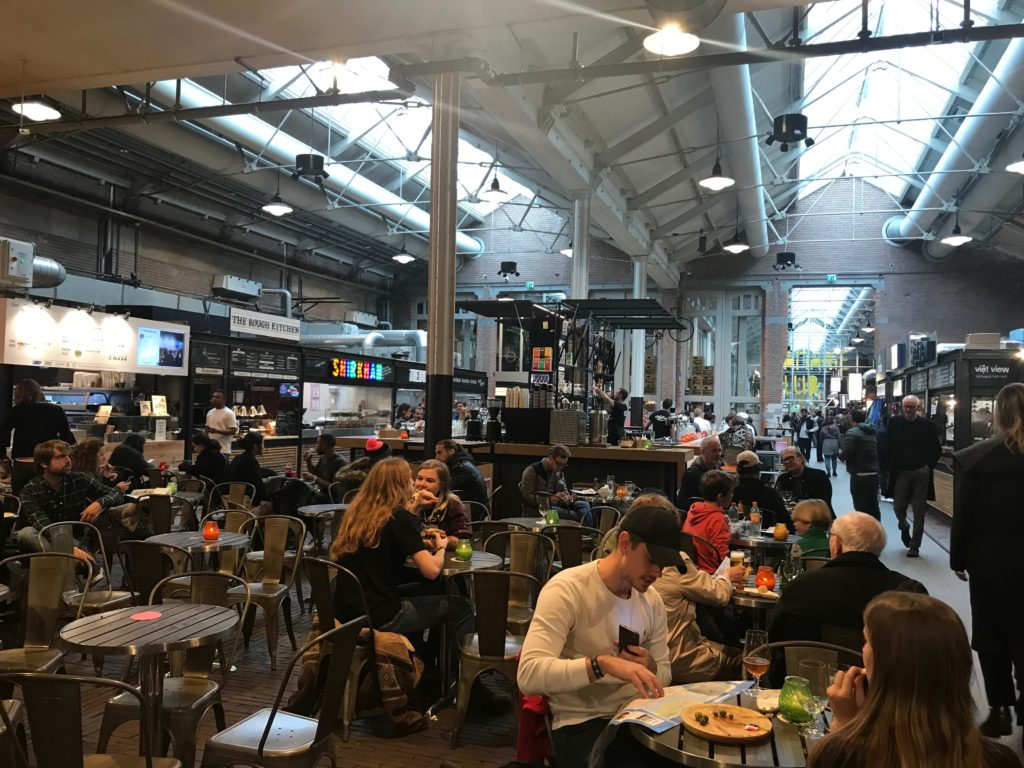 Foodhallen in Amsterdam, Netherlands is a unique old tram depot turned indoor food court that has something for everyone!