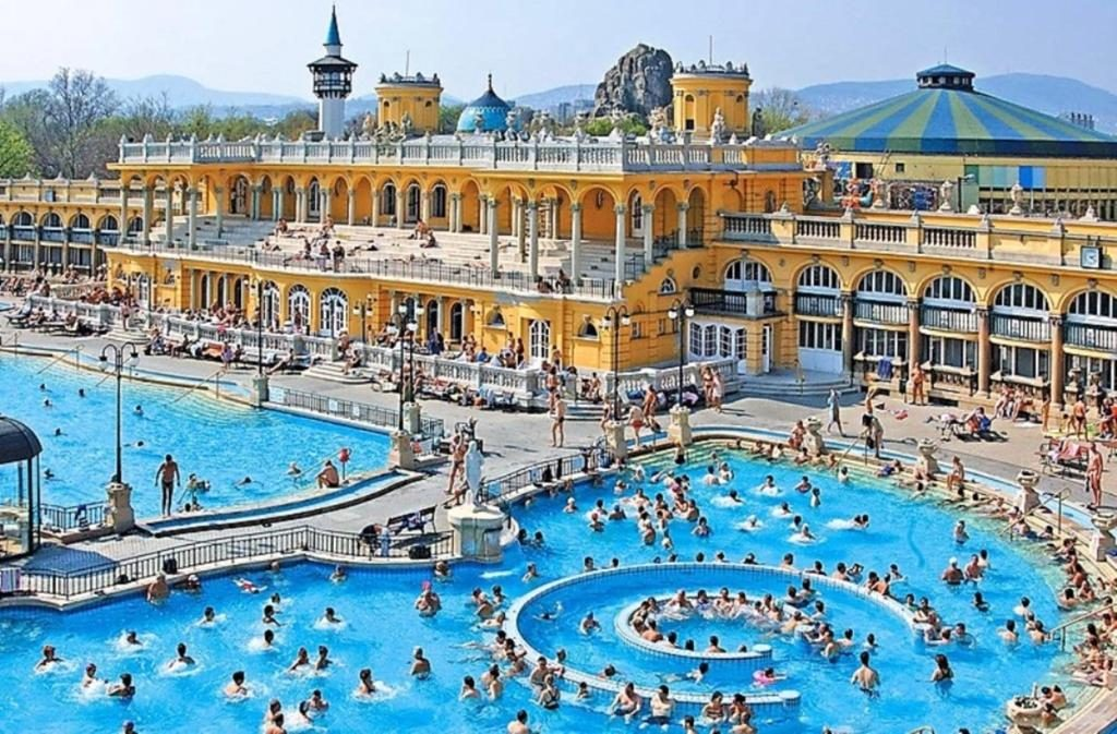 Szechenyi Baths, in Budapest, Hungary, from above with its bright yellow colored building and extra large blue bath