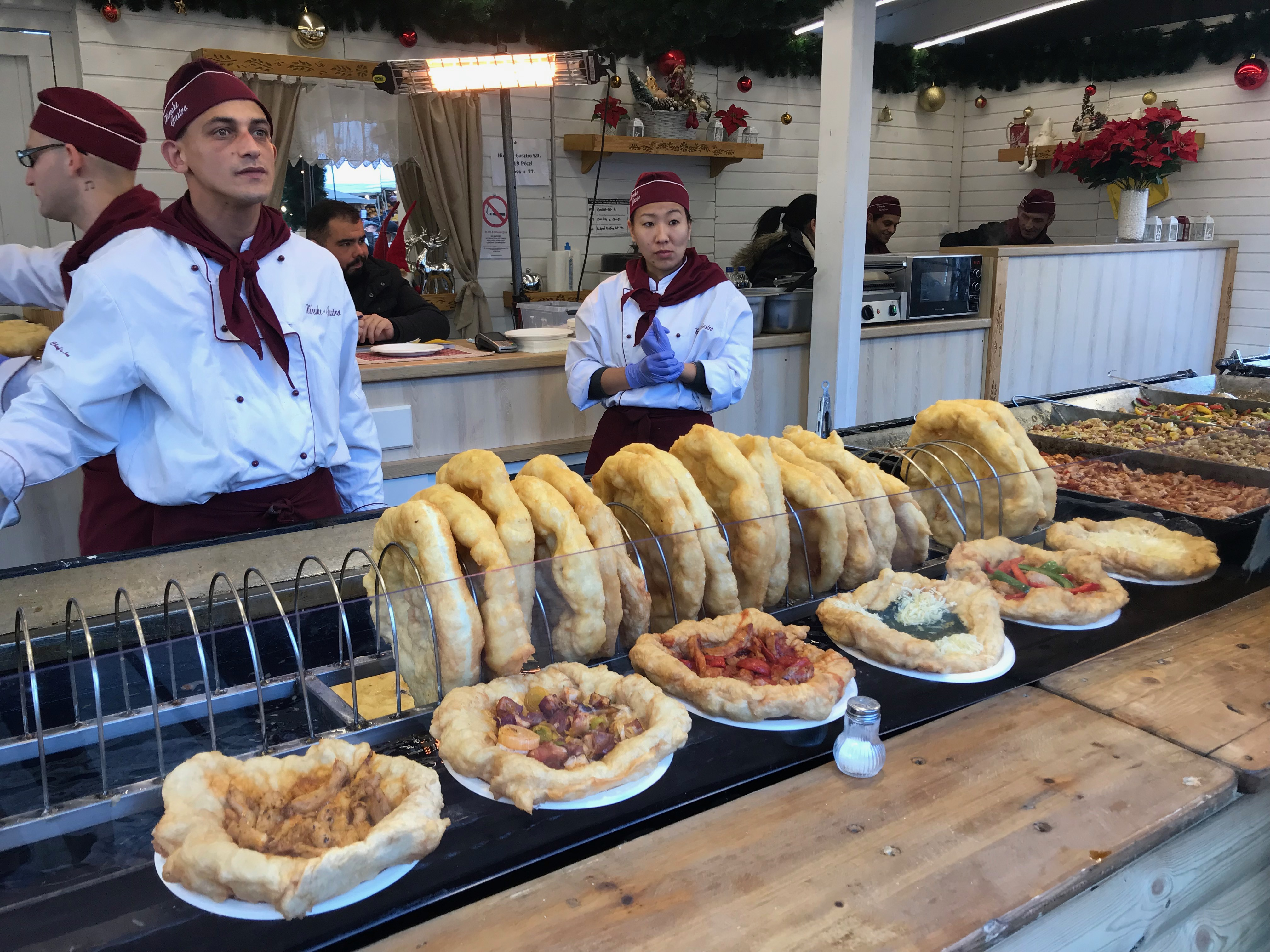 Langos lined up for eating in Budapest, Hungary, with their many different flavors